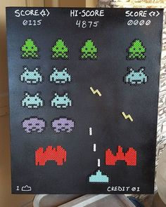 Space Invaders perler beads on canvas by thecatmechanic