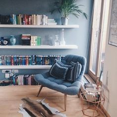 Cool blues and copper accents = bliss. | 17 Adorable Reading Nooks That Are Cosy AF