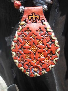 Leather pendant set with red agate. Strung with red chrysocolla, ocean jasper, African turquoise, coral, carnelian, howlite and silver-plated brass beads. Silver-plated brass fob clasp. $80. BP5. www.feeko.co.za
