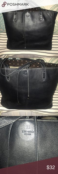 Kate Spade Black Tote Kate Spade black tote  Excellent condition  Black leather Italy tote  No outer flaws- some minor staining on inside/interior of bag (see pic of interior) Photos to show how much this can hold  Reposh, bought it for work (cost me $50 with shipping and everything) and then my hubby gave me a bag and he will be grumpy if I don't use the one he bought me 😂 Any questions just ask :) kate spade Bags