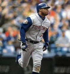 Toronto Blue Jays  Photo (2001) - Shannon Stewart in the Toronto Blue Jays road uniform with American League 100th anniversary patch during 2001 season