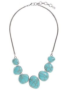 Bold necklace featuring oversized turquoise-hued stones and a burnished silver-tone finish.<br/><br/>• 19 inches long (plus 2 inch extender chain) x 1.3 inches high