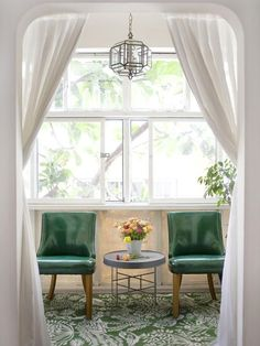 Green chairs and rug with simple and clean white curtains