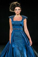Model walks the runway in an outfit by Mireille Dagher for the Mireille Dagher Spring Summer 2011 fashion show, during Couture Fashion Week, September 10, 2010.