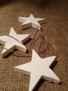 cluster of wooden stars painted white by Lemongrass0811 on Etsy