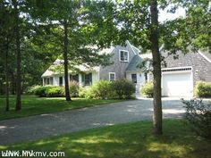 #MarthasVineyard #realestate. Traditional expanded cape on a quiet private road abutting West Chop Woods. This comfortable home features granite countertops in the country kitchen, two fireplaces, beamed ceilings, central hallway, and lovely patio surrounded with lush plantings.  www.lighthousemv.com/marthas-vineyard-island-wide-sales-240.html