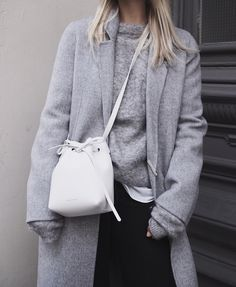 New Era fitted cap, Acne Studios coat and knit jumper, Mansur Gavriel bucket bag. Via Mija