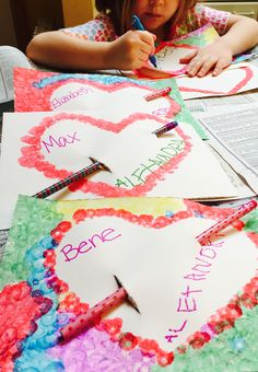 Homemade Valentine's. Use paint dabbers around a heart stencil. Let pain dry. Add pencil and names.