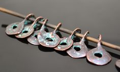 10 Mykonos Greek Casting Beads - 11mm Doodad Cornflake - Copper and Green Patina - 10 BEADS. $6.50, via Etsy.