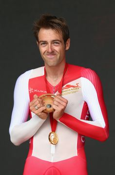 Alex Dowsett celebrates with this Gold medal after the Men's Cycling Road TT Glasgow 2014 (Photo by Ryan Pierse/Getty Images) Alex Dowsett, Men's Cycling, Commonwealth Games, Glasgow Scotland, July 31, Cyclists, Great British, The Man, United Kingdom