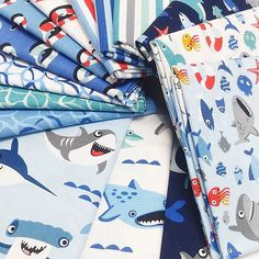 Sharktown by Shawn Wallace is here! These shark prints are absolutely adorable! I am thinking I need to make a swim or beach bag out of this fabric! #sharktownfabric #shawnwallacefabrics #doodlegirlshawn #fabricismyfun #rileyblakedesigns