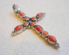 Coral and sterling silver cross pendant