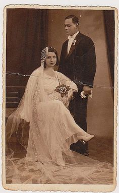 Wedding Couple Romania 1932.  What a jaunty angle her cap has.  A very stylish bride, indeed.