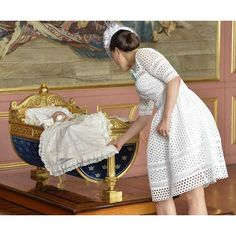 Crown Princess Victoria looking at her son Prince Oscar at his christening today