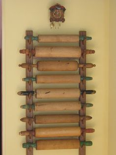 Vintage Kitchen Vintage rolling pins displayed on a simple rack. Vintage Values: Home Collections.