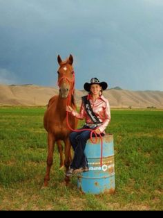 Senior pictures.  Love the barrel racing, horse, rodeo, and outdoor scene.  Fun picture!!