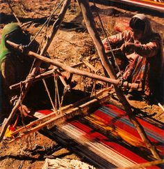 Two nomads from the Zoreh valle in central-southern Iran busily at work weaving a kilim.