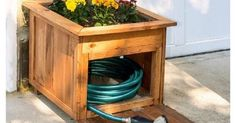 DIY Pallet Wood Hose Holder with Planter - 15 Popular DIY Projects from Pinterest Thatll Make Your Home A Better Place