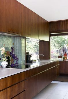 Original Kitchen. Purple horse sculpture designed by Renee and carved in Ubud, Bali. Styling – Anna Flanders, Photo - Angelita Bonetti for The Design Files.