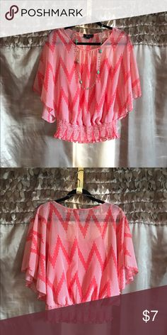 Flowy coral top Kimono sleeve top with elastic waist and attached inner cami. Fabric is semi sheer and coral with white polka dots. BCX Tops Blouses