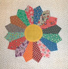 Try this Pattern to Make Easy Dresden Plate Quilt Blocks: A Dresden Plate quilt block by Joy.