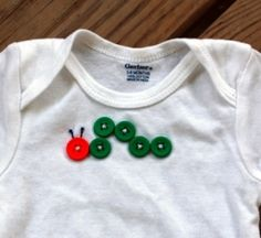 Too cute (and sooo easy)!  5 green grass buttons & 1 orange red  all same size   black emb. thread for antanna