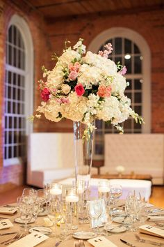 Add drama and height to an airy room! Large mixed arrangement of hydrangeas, roses, spray roses, and orchids - by Tre Bella  Read More: http://www.stylemepretty.com/2014/06/06/classic-glamour-in-durham/