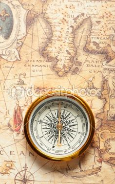 old compass on ancient map a compass with the antique image of a direction