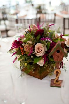 centerpieces with adorable birdhouse inspired table numbers