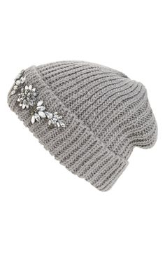Glittery crystal flowers bloom along the cuff of a slouchy beanie in a soft, chunky knit.