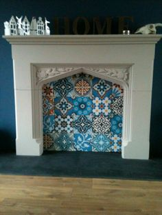 Love the idea of a fireplace surround with a mirror or tiled wall in place of insert