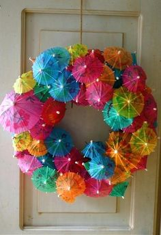 Drink Umbrella Wreath Here is a great fun idea for a summer wreath for your front door. Get a Styrofoam wreath and stick a ton of fun drink umbrellas in them. This would be so great to put out while hosting a luau or summer swim party! Umbrella Wreath, Mini Umbrella, Beach Umbrella, Umbrella Decorations, Umbrella Crafts, Umbrella Centerpiece, Umbrella Tree, Fun Crafts, Arts And Crafts