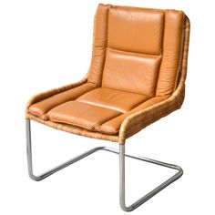 """Striking Mid Century Modern woven rattan, leather and chrome occasional chair, c. 1970s. Dimensions: 34"""" h x 24"""" w x 24"""" d Seat height 16"""""""