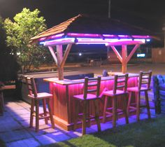Tiki furniture is growing in popularity due to its tropical beach setting. There are many materials used for tiki bar furniture such as bamboo, wicker, tropical plants, etc. Pool Bar, Deck Bar, Patio Bar, Patio Decks, Diy Patio, Outdoor Tiki Bar, Outdoor Decor, Outdoor Bars, Bar Furniture
