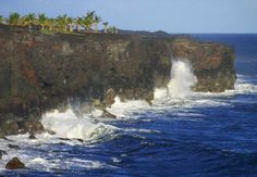 Near the border separating the Big Island districts of Ka'u and Puna on the southernmost Hawaii coastline, one stands in reverence as well-traveled ocean swells crash into the volcanic, palm-lined cliffs of Ka'u. Taken from just inside Hawaii Volcanoes National Park at the end of Chain of Craters Road, this picture shows the power--both in water and earth--of... #hawaii #kau