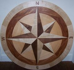 Hardwood Floor Medallion Inlays and Compass Roses Intarsia Woodworking, Woodworking Box, Carved Wood Wall Art, Wood Shop Projects, Porch Flooring, Compass Rose, Floor Patterns, Wood Slab, Floor Design
