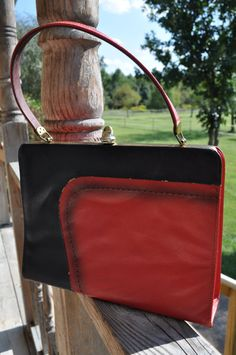 Classic bag in Good Condition  Exterior: Leather, red and black  Interior: gold satin/silky material    1960's $18.00