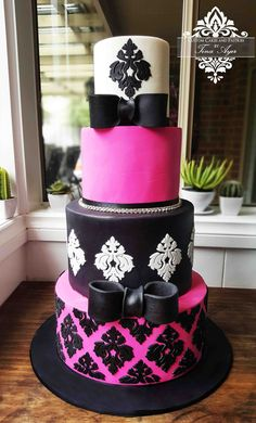 Hot Pink and black and white Damask cake with bows. Designed and Handmade by Custom Cakes and Pastries by Tina Ayer Made in Melbourne Australia www.customcakesandpastriesbytinaayer.com.au Facebook: https://www.facebook.com/CustomCakesandPastriesbyTinaAyer/ instagram: https://www.instagram.com/customcakesbytinaayer/
