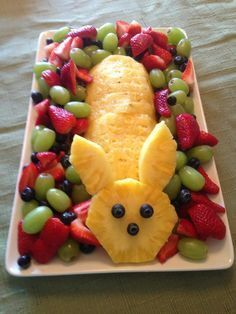 Easter Fruit Tray...Just cut a bunny's head out of pineapple, the body is just slices of pineapple. The eyes are blueberries that are pinned with toothpicks