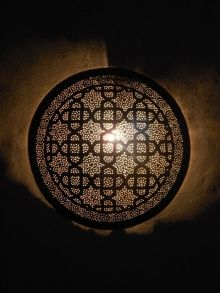 Moroccan Lamps and Lights, round shaped Sconce and its remarkable openwork patterns.