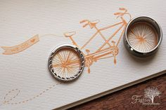 a tandem bike themed wedding invitation made a perfect backdrop for the wedding ring set