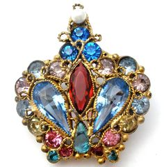 "Designer Jewelry Brooches - This is an early gold plated wire work crown brooch with multi colored open & closed back rhinestones and a faux pearl. This crown measures 1.5"" by 1.75"" and is an unsigned                                                                                                                                                                                 More"