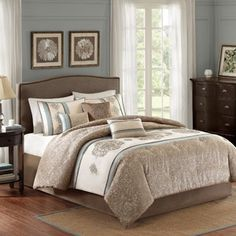 Better Homes and Gardens Medallion 7-Piece Comforter Bedding Set.  I would get this in King-sized so it will hang nearer to the floor.