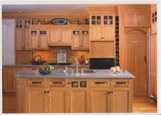 craftsman cabinets kitchen - Google Search;could this be cabinets in the fireplace wall built-ins, with the glass like this.?