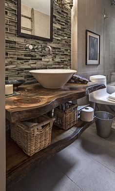 I like the vanity with shelf underneath, use of storage, and tile wall (although not those tiles). Great coloring in the wood counter.