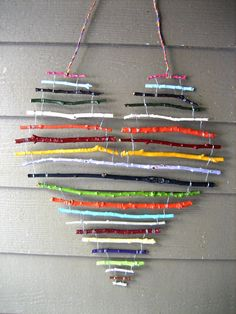 art for the cottage porch - painted sticks wired together and hung with electrical wire