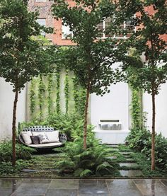 A thoughtfully designed garden in New York City makes way for an existing fountain by landscaping vertically around it. The water feature includes an Italian marble spout designed by Thomas Woltz.