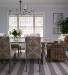 Gorgeous coastal dining room in soothing grey and white stripes. L.O.V.E.