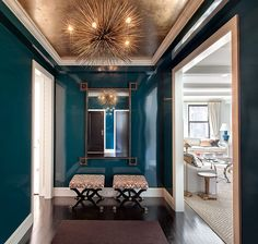 Make an Entrance. Blue lacquer walls with a gold leaf ceiling. Interior Designer: Lilly Bunn