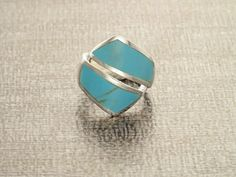 Simple and Chic in Design, this Sterling Silver Statement Ring is set with a Turquoise Gemstone with a Rich Blue Color.  Ring features is 2.0 cm width Average silver weight : 6.0 gr.  ►INTERNATIONAL SHIPPING : we use French Priority International Shipping, 5-10 days, Tracking Number and Insurance Included. ►Your Ring will come in a beautiful Ring Case, ideal for gifts or just storing your jewelry safely. It will be posted in an extremely secure package to make sure its safe arrival at your…